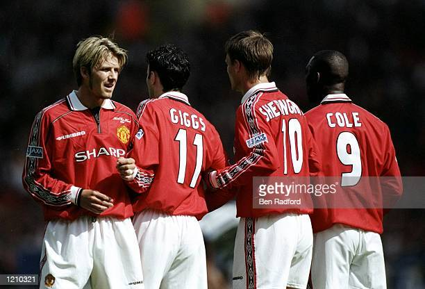 Teddy Sheringham David Beckham Ryan Giggs and Andy Cole of Manchester United lineup a defensive wall during the AXA FA Cup Final match against...