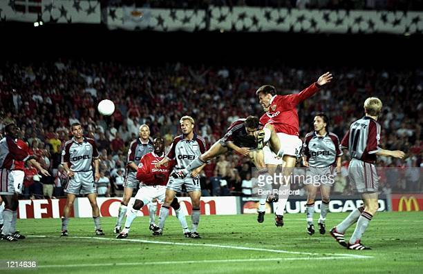 Teddy Sheringham of Manchester United heads goalwards during the UEFA Champions League Final against Bayern Munich at the Nou Camp in Barcelona,...
