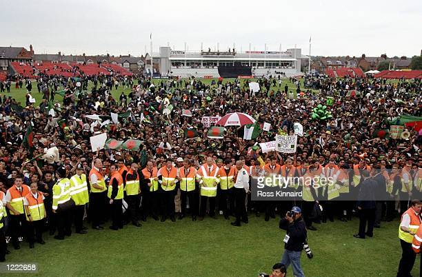 The Bangladesh fans gather on the pitch after Bangladesh win the Cricket World Cup Group B match against Pakistan played in Northampton England...