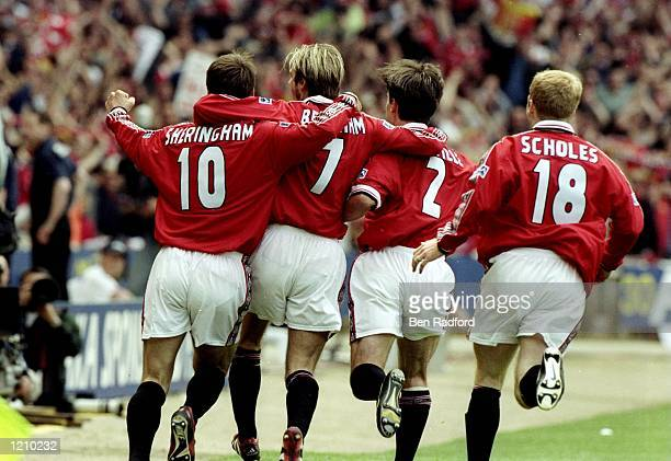 The Manchester United players celebrate victory after the AXA FA Cup Final match against Newcastle United played at Wembley Stadium in London England...
