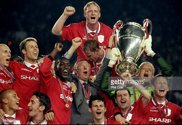 The Manchester United team celebrate with the European Cup after winning the European Champions League Final against Bayern Munich in the Nou Camp...