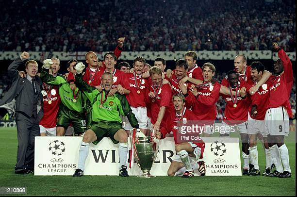 The Manchester United team with the European Cup celebrate victory over Bayern Munich in the European Champions League Final in the Nou Camp Stadium...