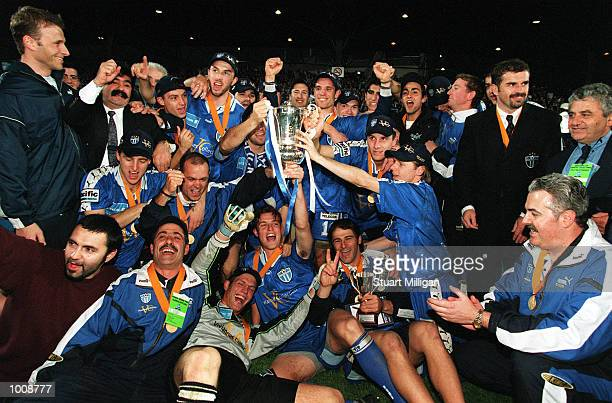 The South Melbourne team celebrate with coaches and team officials after the win in the NSL Grand Final Match between South Melbourne and Sydney...