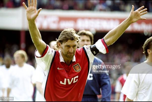 Tony Adams of Arsenal salutes the crowd during the FA Carling Premiership match against Aston Villa played at Highbury in London England The match...