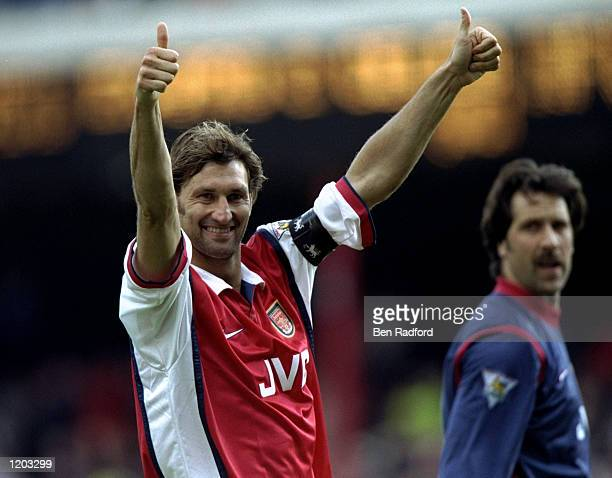 Tony Adams of Arsenal salutes the fans during the FA Carling Premiership match against Aston Villa played at Highbury in London England The match...