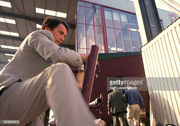 19 May 1999 UEFA Cup Winners Cup Final BBC Television commentator Alan Hansen struggles on a ladder as he climbs to the commentary box at Villa Park