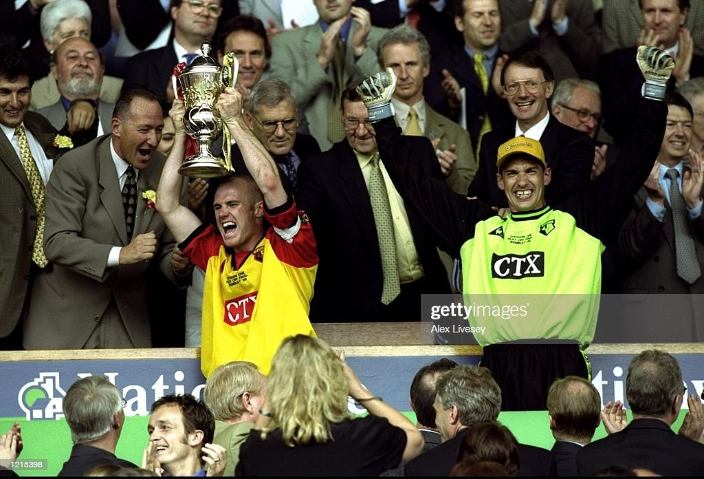 Watford captain Robert Page lifts the play-off trophy during the Nationwide Division One Play-Off Final match against Bolton Wanderers played at Wembley Stadium in London, England. The match finished in a 0-2 victory for watford and theygained promotion to the premiership. \ Mandatory Credit: Alex Livesey /Allsport