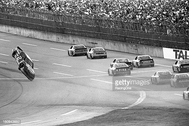Rusty Wallace catches some air as he takes the checkered flag crossing the startfinish line to finish sixth in the Winston 500 NASCAR Cup race at...