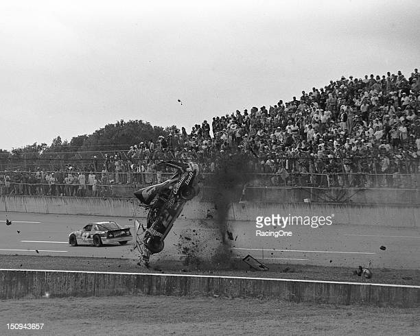 Rusty Wallace's car gets ripped apart after he crashed and flipped at the finish of the Winston 500 NASCAR Cup race at Talladega Superspeedway...