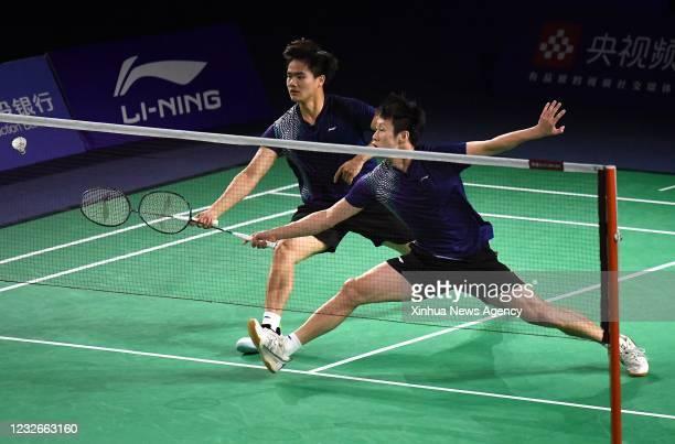 May 2, 2021 -- Ren Xiangyu R/Liang Weikeng of Guangdong compete during the men's doubles' final between Ren Xiangyu/Liang Weikeng of Guangdong and...