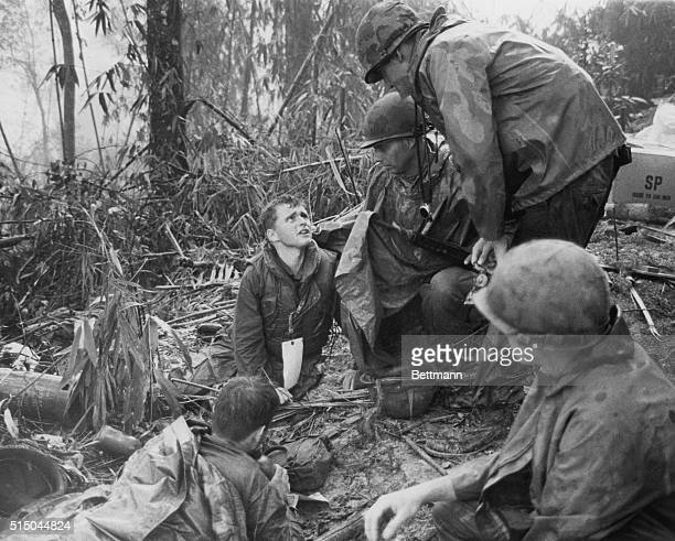 May 20 1969 A Shau Valley South Vietnam A wounded 101st Airborne trooper talks with a chaplain on 'Hamburger Hill' overlooking the A Shau Valley...