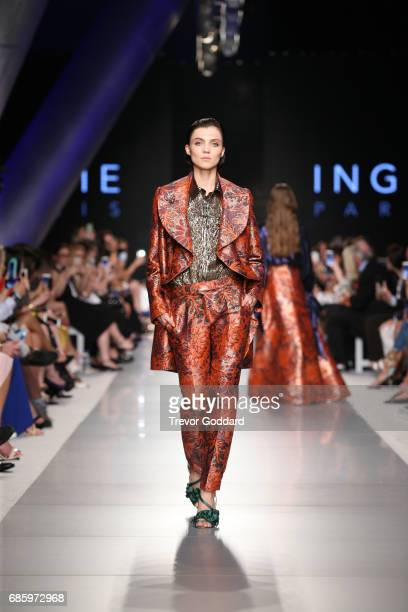 A model walks the runway during Designer Ingie Paris's show at Arab Fashion Week Ready Couture Resort 2018 on May 20 2017 at Meydan in Dubai United...