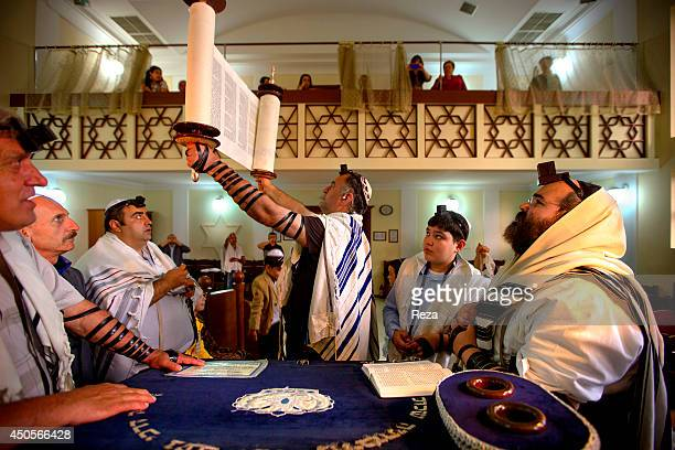 May 20 Baku Azerbaijan At a Bar Mitzvah the Torah is held up during the Torah reading service to display it to the congregation The men wear Tefillin...