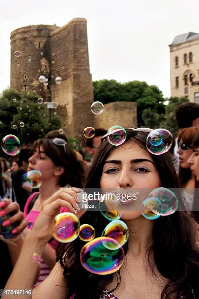 May 20 Flower Festival Old City Baku Azerbaijan Girls play with bubbles handed out by a youth flash mob that performed during the Flower Festival...