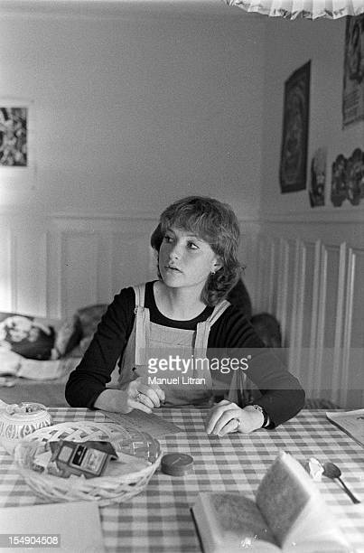 May 20 the actress Isabelle Huppert in his apartment during the film 'The Lacemaker' by Claude Goretta Isabelle Huppert sitting at a table