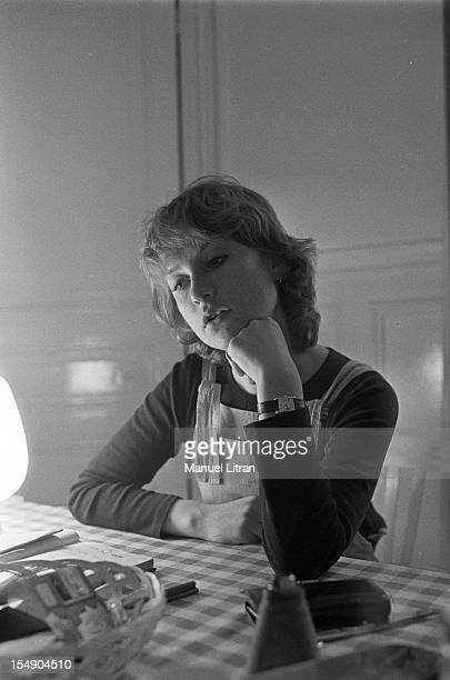 May 20 the actress Isabelle Huppert in his apartment during the film 'The Lacemaker' by Claude Goretta Portrait of Isabelle Huppert sitting at a table