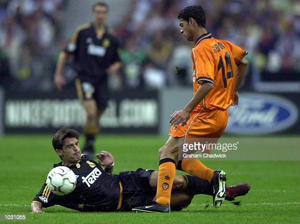 Aitor Karanka of Real Madrid comes into challenge Gerard of Valencia during the match between Real Madrid and Valencia in the UEFA Champions League...