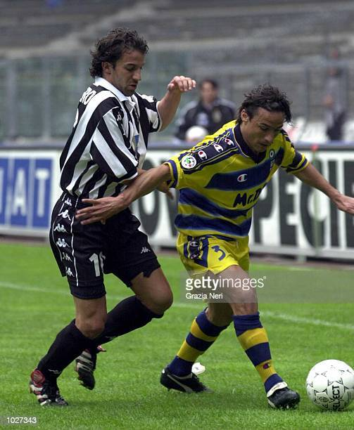 Alessandro Del Piero of Juventus battles for possesion with Antonio Benarrivo of Parma during the Serie A match between Juventus and Parma at the...