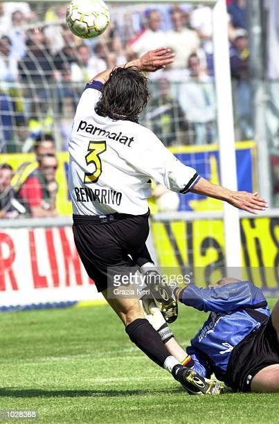 Antonio Benarrivo of Parma chips Antonio Climenti of Lecce during the Serie A match betwen Parma and Lecce at the Ennio Tardini Stadium Parma Italy...
