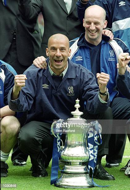 Chelsea manager Gianluca Vialli with the trophy after beating Aston Villa in the AXA FA Cup Final at Wembley Stadium in London England Chelsea won 1...