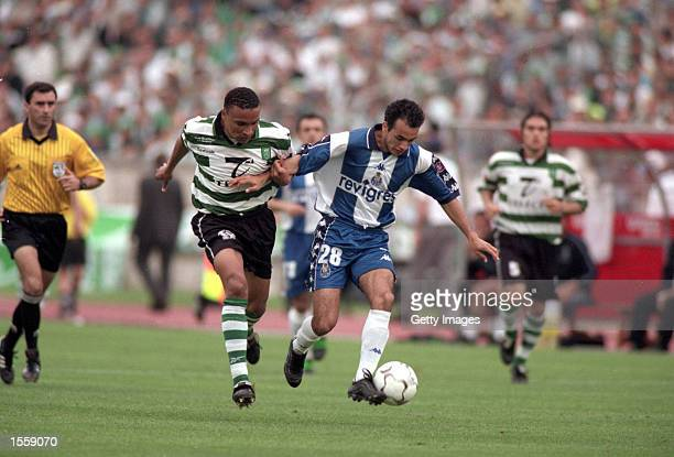 Clayton of Porto takes on Vidigal of Sporting Lisbon during the Portuguese Cup Final in the Estadia Nacional stadium in Lisbon The game finished as a...