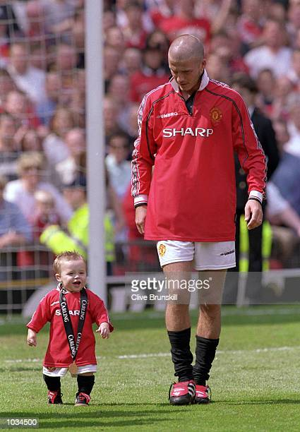 David Beckham of Manchester United and his son Brooklyn before the FA Carling Premiership match against Tottenham Hotspur at Old Trafford in...