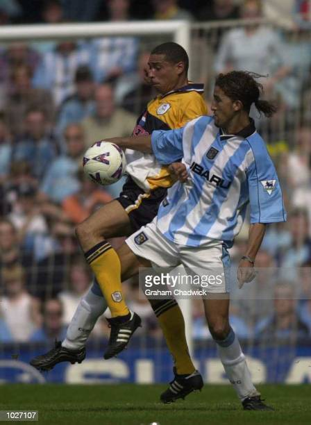 Des Walker of Sheffield Wednesday and Moustapha Hadji of Coventry during the FA Premiership game between Coventry City and Sheffield Wednesday at...