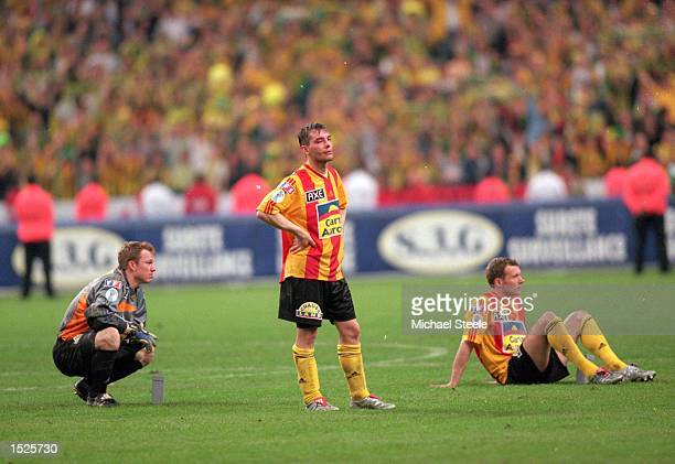 Despair for Cedric Schille and Fabrice Baron of Calais after defeat in the French Cup Final against Nantes at the Stade de France in St Denis, Paris,...
