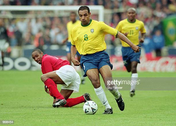 Emerson of Brazil runs with the ball during the International Friendly match against England played at Wembley Stadium, in London. The match ended in...