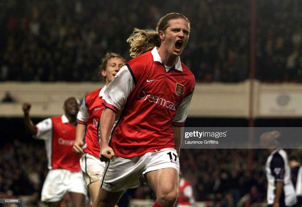 Emmanuel Petit of Arsenal celebrates scoring the winning goal in the last minute during the match between Arsenal and West Ham United in the FA Carling Premiership at Highbury, London. Mandatory Credit: Laurence Griffiths/ALLSPORT