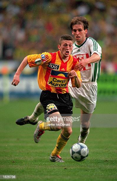 Emmanuel Vasseur of Calais goes past Mathieu Berson of Nantes during the French Cup Final against Calais at the Stade de France in St Denis Paris...