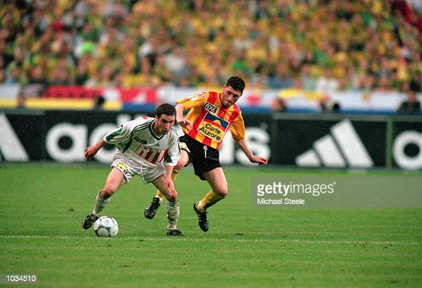 Eric Carriere of Nantes holds off Jerome Dutitre of Calais Racing during the French Cup Final at the Stade de France in Paris France Nantes won the...