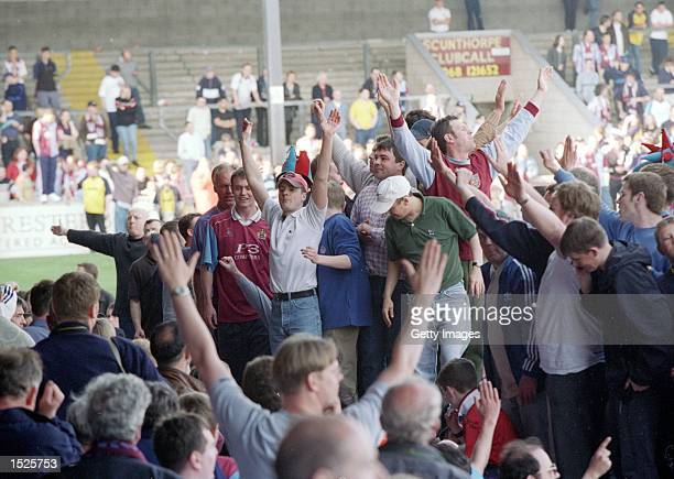 Fans invade the pitch after Burnley secure promotion from Nationwide League Division Two after their 21 win against Scunthorpe United at Glanford...