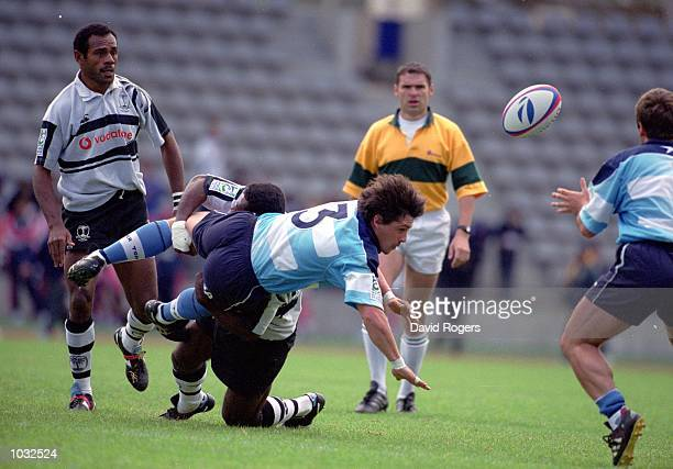 Fernando Del Castillo of Argentina is tackled during the Air France Paris sevens match against Fiji at the Charlety Stadium in Paris France Argentina...