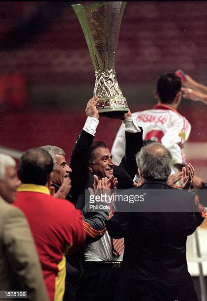 Galatasaray coach Fatih Terim celebrates after the UEFA Cup final against Arsenal at the Parken Stadium in Copenhagen Denmark The match finished 00...