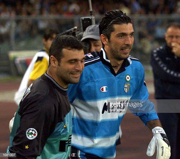 Gianluigi Buffon of Parma greets Angelo Peruzzi of Inter before the Serie A fourth place playoff match to determine who takes the final Champions...