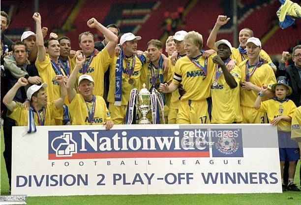 Gillingham celebrate after the Division 2 PlayOff Final against Wigan at Wembley Stadium London England Gillingham won 32 Mandatory Credit Gary M...
