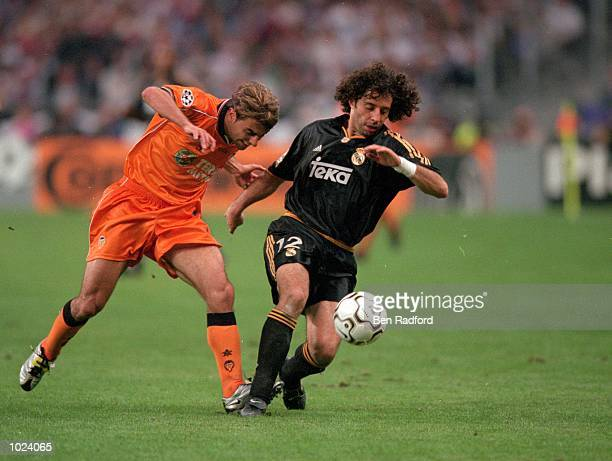 Ivan Campo holds off Claudio Lopez of Valencia during the European Champions League Final 2000 at the Stade de France SaintDenis France Real Madrid...