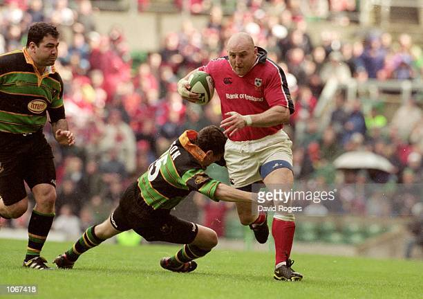 Keith Wood of Munster is tackled by Paul Grayson of Northampton during the Heineken Cup Final at Twickenham in England. Northampton won the match...