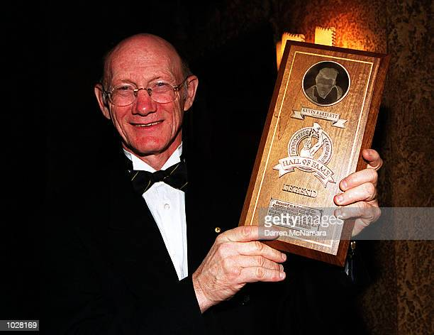 Kevin Bartlett with his AFL Hall of Fame' Legend' award for the year 2000 during the Hall Of Fame dinner which was held at the Regent Ball room in...