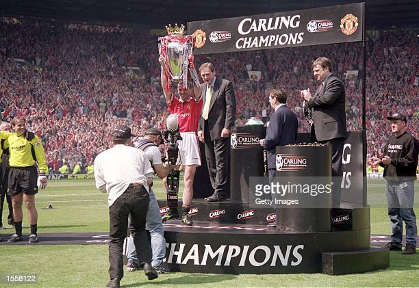 Manchester United captain Roy Keane lifts the championship trophy after the FA Carling Premiership match against Tottenham Hotspur at Old Trafford in...