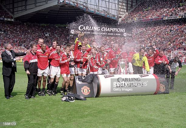 Manchester United celebrate winning the championship after the FA Carling Premiership match against Tottenham Hotspur at Old Trafford in Manchester...