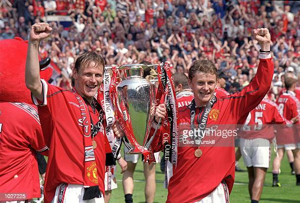 Manchester United's Teddy Sheringham and Ole Gunnar Solskjaer lift the championship trophy after the FA Carling Premiership match against Tottenham...