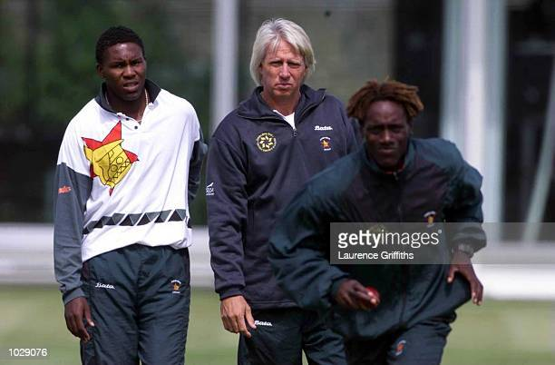 Mpumelelo Mbangwa of Zimbabwe and coach Geoff Thompson watch Henry Olonga bowl during net training ahead of the 1st Test against England at Lords in...