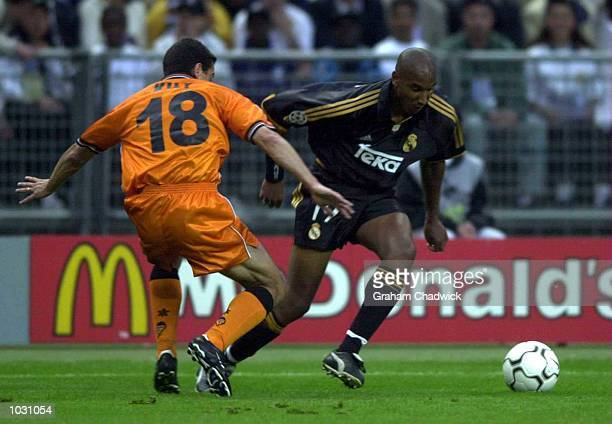 Nicolas Anelka of Real Madrid takes on Kily Gonzalez of Valencia during the match between Real Madrid and Valencia in the UEFA Champions League Final...