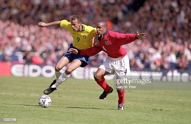 Paul Ince of England holds off Franca of Brazil during the International Friendly match at Wembley Stadium in London The match was drawn 11 Mandatory...