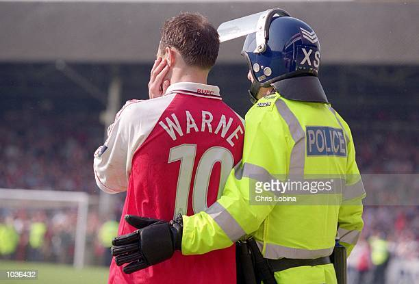 Paul Warne of Rotherham United is accompanied by a policeman during the Nationwide Division Three match against Swansea City at Millmoor in Rotherham...