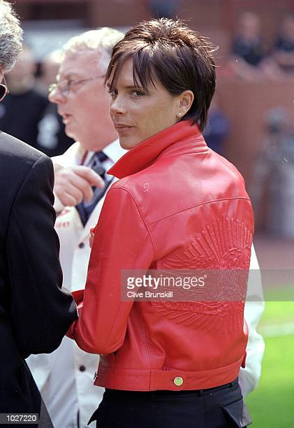 Posh Spice Victoria Beckham joins in Manchester United's championship winning celebrations after the FA Carling Premiership match against Tottenham...