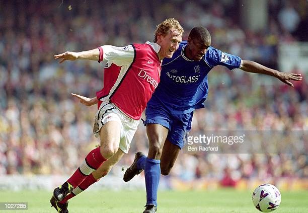 Ray Parlour of Arsenal and Bernard Lambourde of Chelsea challenge for the ball during the FA Carling Premiership game at Highbury in London England...