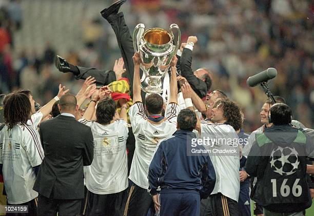 Real Madrid players hold up the Madrid coach Vicente Del Bosque after the European Champions League Final 2000 against Valencia at the Stade de...